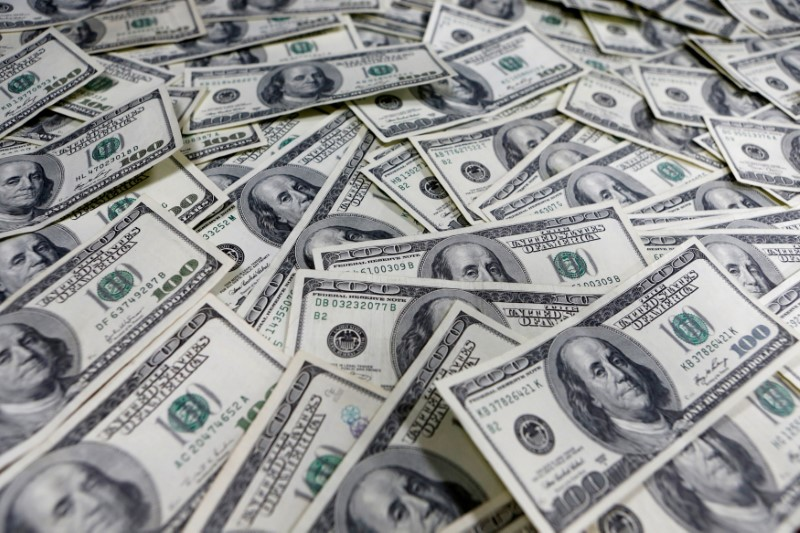 Dollar dips as investors brace for surge in jobless claims