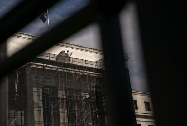 © Bloomberg. The Marriner S. Eccles Federal Reserve building stands in Washington, D.C., U.S., on Tuesday, March 17, 2020. The Trump administration is backing sending direct payments of $1,000 or more to Americans within two weeks as part of an $850 billion plan to blunt some of the economic impact of the widening coronavirus outbreak. Photographer: Andrew Harrer/Bloomberg